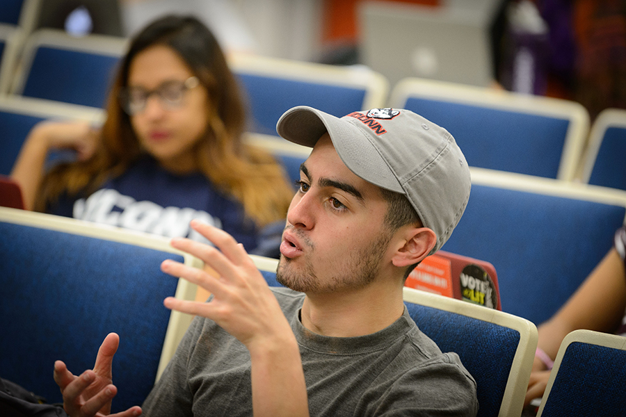 A student engages in a conversation in class.