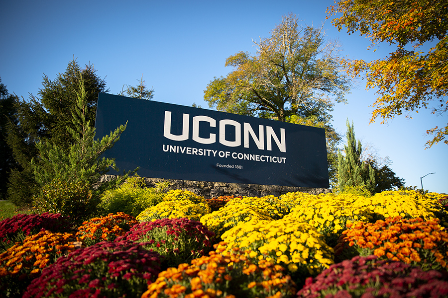 The UConn sign on a sunny fall day.